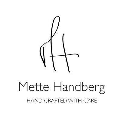 mette handberg logo